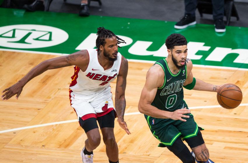 Jayson Tatum #0 of the Boston Celtics dribbles past Trevor Ariza #8 of the Miami Heat (Photo by Kathryn Riley/Getty Images)