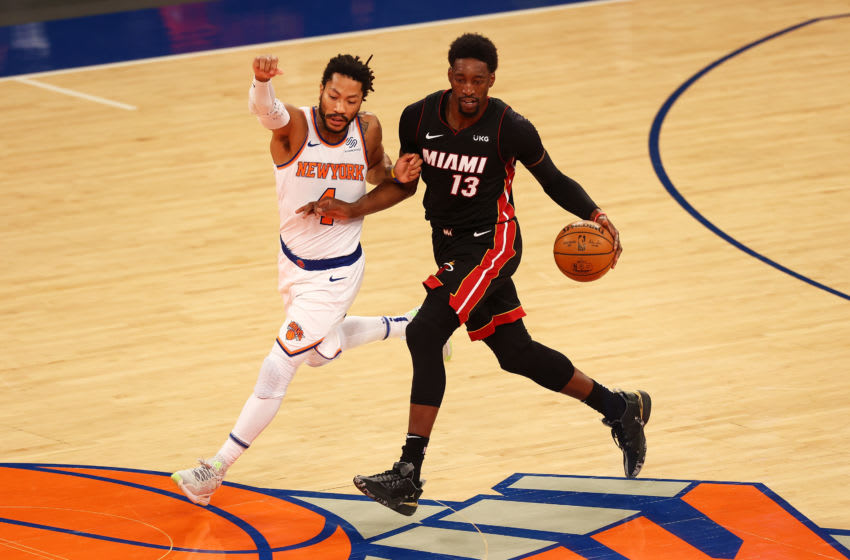 Derrick Rose #4 of the New York Knicks defends against Bam Adebayo #13 of the Miami Heat (Photo by Mike Stobe/Getty Images)
