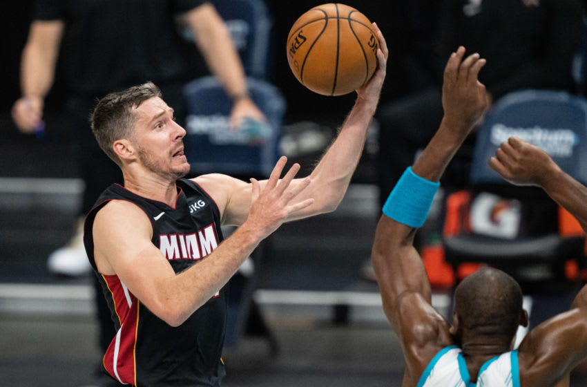 Goran Dragic #7 of the Miami Heat drives to the basket against Bismack Biyombo (Photo by Jacob Kupferman/Getty Images)