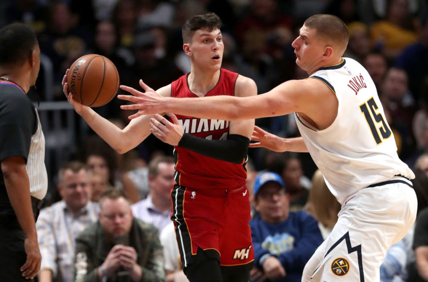 Tyler Herro #14 of the Miami Heat is guarded by Nikola Jokic #15 of the Denver Nuggets in the fourth quarter. (Photo by Matthew Stockman/Getty Images)