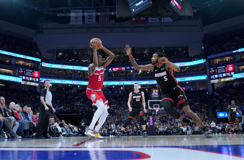 De'Aaron Fox #5 of the Sacramento Kings collides with Derrick Jones Jr. #5 of the Miami Heat (Photo by Thearon W. Henderson/Getty Images)