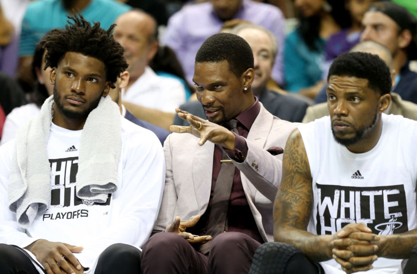 Chris Bosh #1 of the Miami Heat talks to teammates Justise Winslow #20 and Udonis Haslem #40 against the Charlotte Hornets (Photo by Streeter Lecka/Getty Images)