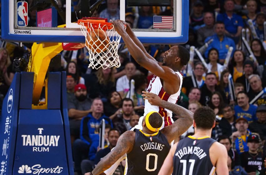 Miami Heat center Bam Adebayo (13) dunks the ball above Golden State Warriors center DeMarcus Cousins (Kelley L Cox-USA TODAY Sports)