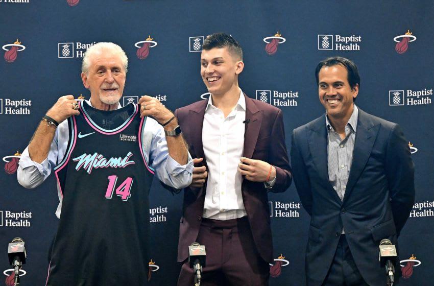 Miami, FL, USA; Miami Heat President Pat Riley (left) holds up Miami Heat guard Tyler Herro jersey (center) next to Heat head coach Erik Spoelstra (right) before a press conference (Steve Mitchell-USA TODAY Sports)