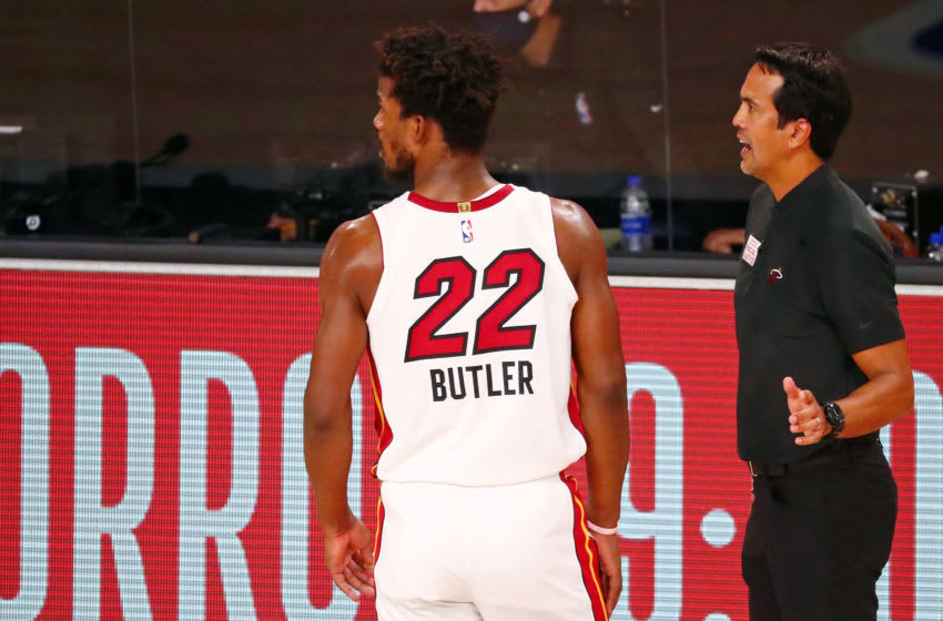 Miami Heat forward Jimmy Butler (22) talks with head coach Erik Spoelstra (Kim Klement-USA TODAY Sports)