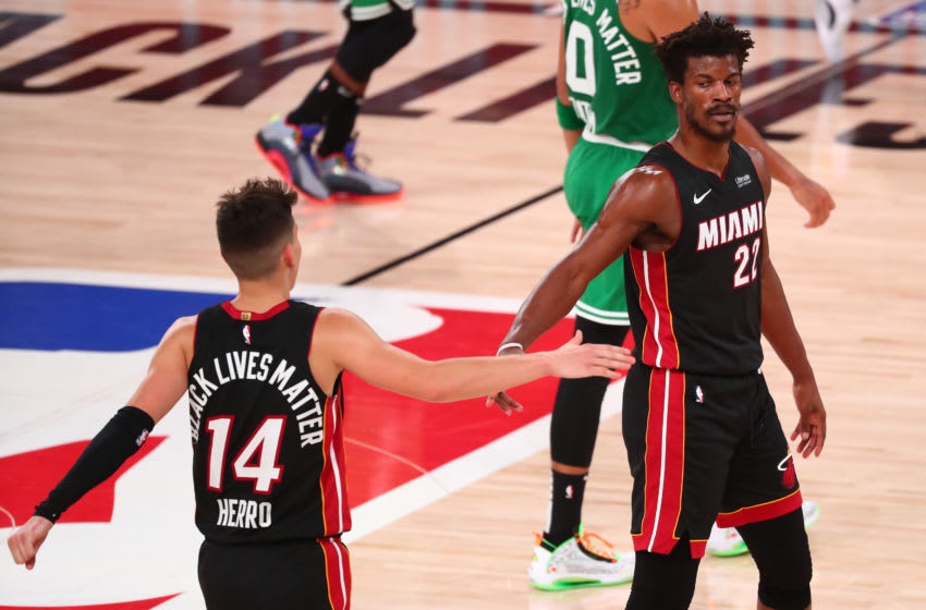 Miami Heat guard Tyler Herro (14) reacts with forward Jimmy Butler (22) during the second half of game four of the Eastern Conference Finals (Kim Klement-USA TODAY Sports)