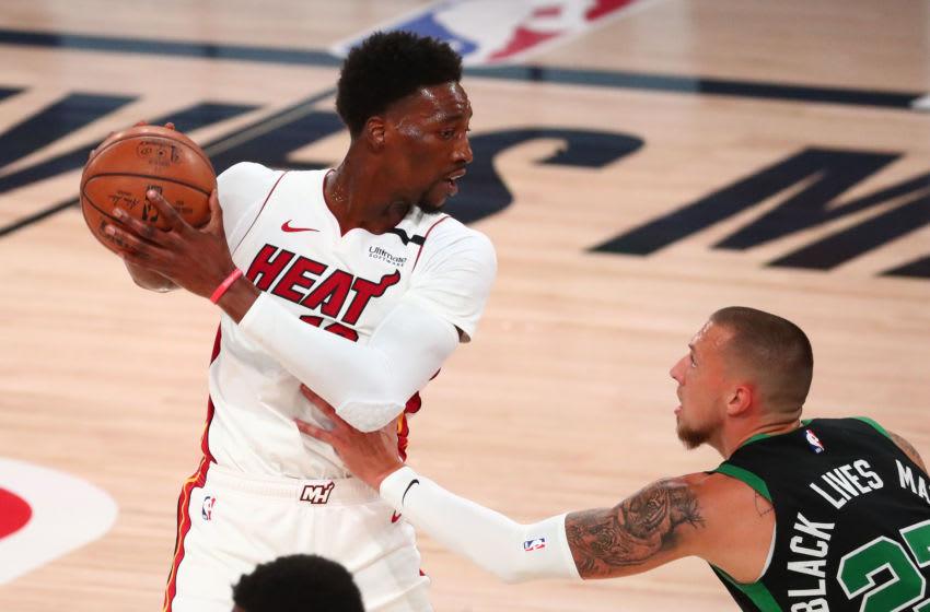 Miami Heat forward Bam Adebayo (13) controls the ball against Boston Celtics center Daniel Theis (27) (Kim Klement-USA TODAY Sports)