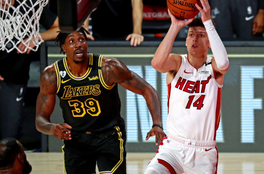 Miami Heat guard Tyler Herro (14) shoots the ball against Los Angeles Lakers center Dwight Howard (39) (Kim Klement-USA TODAY Sports)