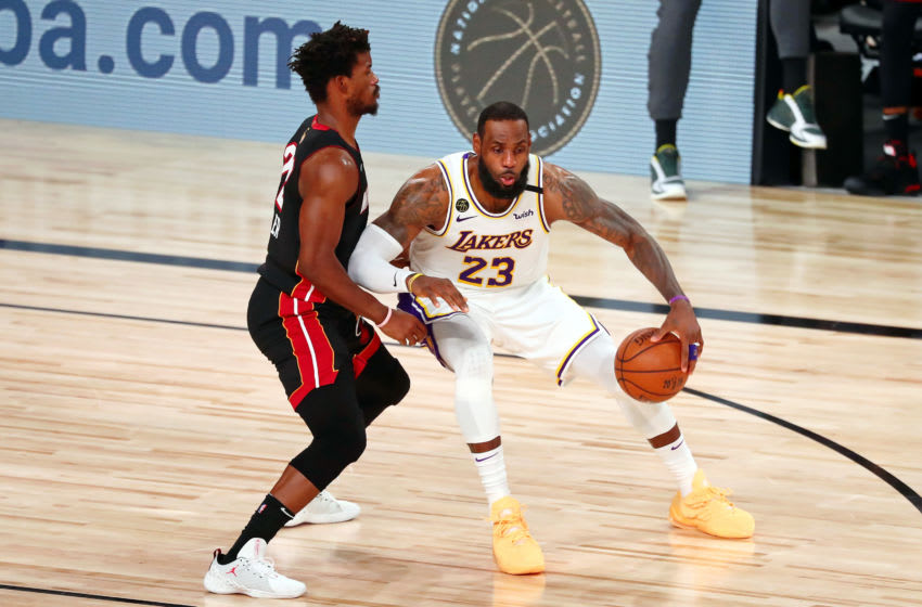 Los Angeles Lakers forward LeBron James (23) dribbles while defended by Miami Heat forward Jimmy Butler (22) (Kim Klement-USA TODAY Sports)