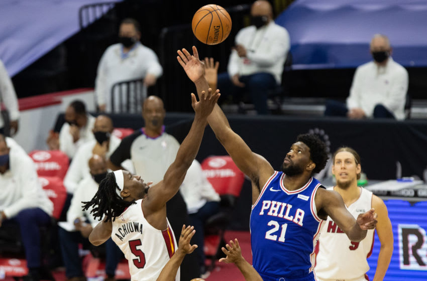 Miami Heat forward Precious Achiuwa (5) and Philadelphia 76ers center Joel Embiid (21) tip off the start the first quarter (Bill Streicher-USA TODAY Sports)