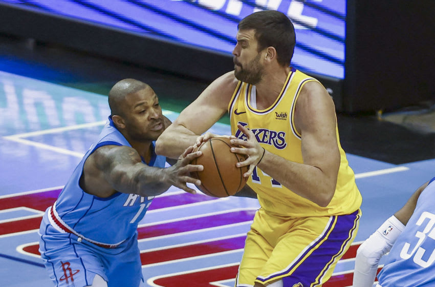 Houston Rockets forward P.J. Tucker (left) battles for the ball with Los Angeles Lakers center Marc Gasol (right) (Troy Taormina-USA TODAY Sports)
