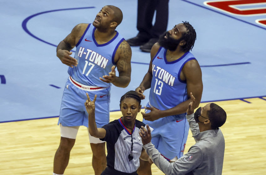 Houston Rockets forward P.J. Tucker (17) and guard James Harden (13) and Rockets head coach Stephen Silas (right) react after a call (Troy Taormina-USA TODAY Sports)