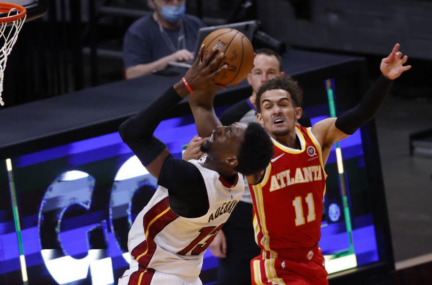 Atlanta Hawks guard Trae Young (11) fouls Miami Heat center Bam Adebayo (13) (Rhona Wise-USA TODAY Sports)