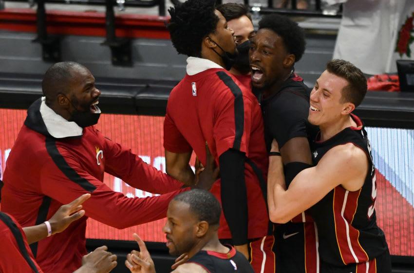 Miami Heat center Bam Adebayo (13) celebrates a winning shot over the Brooklyn Nets (Jim Rassol-USA TODAY Sports)