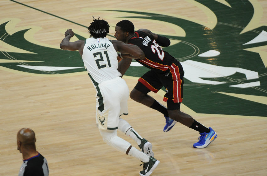 Milwaukee Bucks guard Jrue Holiday (21) guards Miami Heat guard Kendrick Nunn (25) (Michael McLoone-USA TODAY Sports)