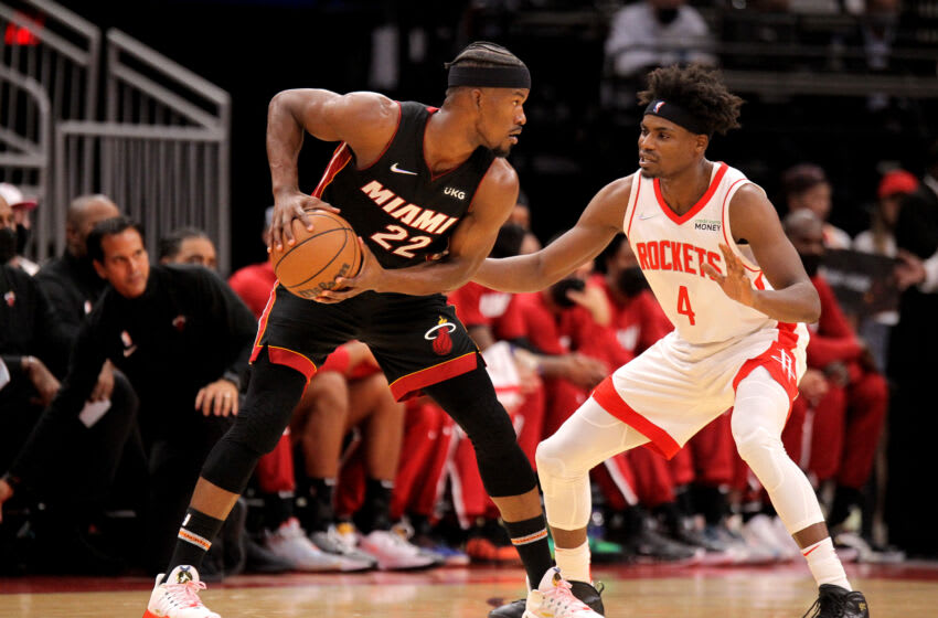 Miami Heat forward Jimmy Butler (22) handles the ball while Houston Rockets forward Danuel House Jr. (4) defends (Erik Williams-USA TODAY Sports)
