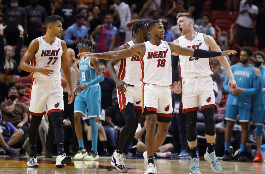 Oct 11, 2021; Miami, Florida, USA; Miami Heat center Omer Yurtseven (77) and guard Marcus Garrett (0) and guard D.J. Stewart (18) and and forward Micah Potter (20) celebrate during the second half against the Charlotte Hornets at FTX Arena. Mandatory Credit: Rhona Wise-USA TODAY Sports