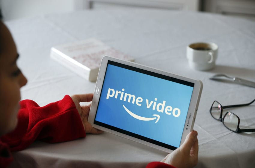 PARIS, FRANCE - NOVEMBER 20: In this photo illustration, the Amazon Prime video media service provider's logo is displayed on the screen of a tablet on November 20, 2019 in Paris, France. Amazon Prime video is a major player in streaming as its competitors, Disney, Netflix, Disney +, HBO and Apple TV. (Photo by Chesnot/Getty Images)