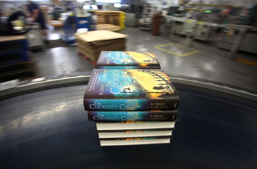 BUNGAY, ENGLAND - JULY 18: Finished copies of 'The Cuckoo's Calling' come off the print line on July 18, 2013 in Bungay, England. JK Rowling has recently been uncovered as the secret author of the new book 'The Cuckoo's Calling' after being published by Sphere under the pseudonym of 'Robert Galbraith.' Since the revelation, sales of the book have soared and the printers of the book, Clays, have had to start reprinting the book in large numbers. (Photo by Jordan Mansfield/Getty Images)
