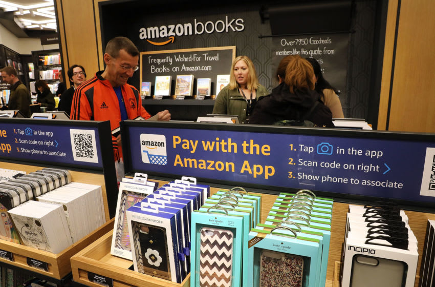 NEW YORK, NY - MAY 25: People shop in the newly opened Amazon Books on May 25, 2017 in New York City. Amazon.com Inc.'s first New York City bookstore occupies 4,000 square feet in The Shops at Columbus Circle in Manhattan and stocks upwards of 3,000 books. Amazon Books, like the Amazon Go store, does not accept cash and instead lets Prime members use the Amazon app on their smartphone to pay for purchases. Non-members can use a credit or debit card. (Photo by Spencer Platt/Getty Images)