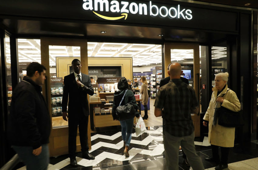 NEW YORK, NY - MAY 25: People enter the newly opened Amazon Books on May 25, 2017 in New York City. Amazon.com Inc.'s first New York City bookstore occupies 4,000 square feet in The Shops at Columbus Circle in Manhattan and stocks upwards of 3,000 books. Amazon Books, like the Amazon Go store, does not accept cash and instead lets Prime members use the Amazon app on their smartphone to pay for purchases. Non-members can use a credit or debit card. (Photo by Spencer Platt/Getty Images)