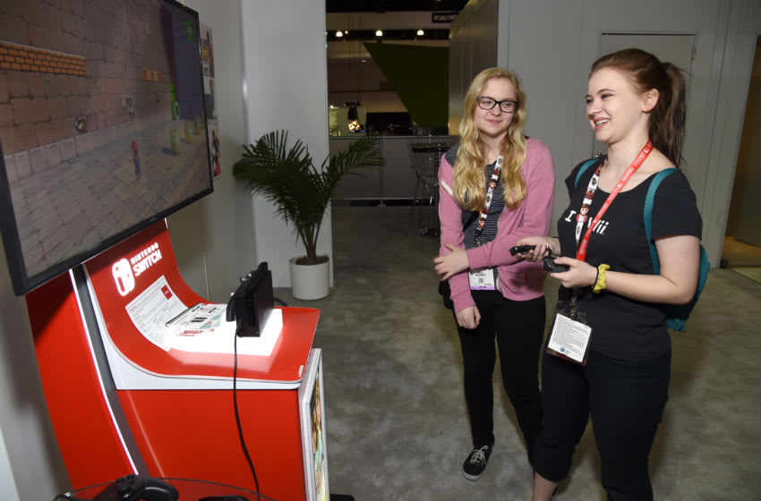 LOS ANGELES, CA - JUNE 15: Actors Kayla McCormick and Sierra McCormick play Super Mario Odyssey at the Nintendo booth at the 2017 E3 Gaming Convention at Los Angeles Convention Center on June 15, 2017 in Los Angeles, California. (Photo by Michael Kovac/Getty Images for Nintendo)
