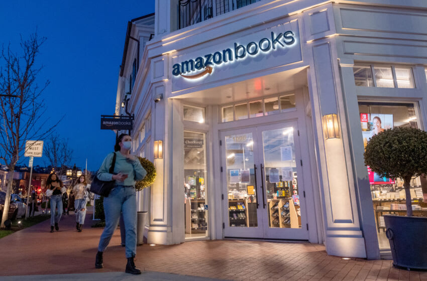LOS ANGELES, CALIFORNIA - APRIL 24: People wearing masks walk past an Amazon Books in the Pacific Palisades amid the coronavirus pandemic on April 24, 2021 in Los Angeles, California.  Los Angeles County moved to orange-level Covid-19 restrictions on April 5, allowing increased capacity in restaurants, cinemas and museums.  (Photo by Alexi Rosenfeld / Getty Images)
