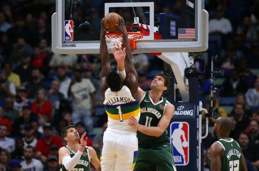 NEW ORLEANS, LOUISIANA - FEBRUARY 04: Zion Williamson #1 of the New Orleans Pelicans dunks against Brook Lopez #11 of the Milwaukee Bucks during the first half at the Smoothie King Center on February 04, 2020 in New Orleans, Louisiana. NOTE TO USER: User expressly acknowledges and agrees that, by downloading and or using this Photograph, user is consenting to the terms and conditions of the Getty Images License Agreement. (Photo by Jonathan Bachman/Getty Images)