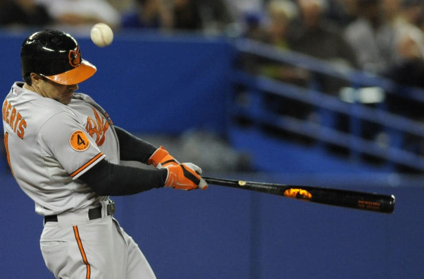 TORONTO, CANADA - SEPTEMBER 15: Brian Roberts #1 of the Baltimore Orioles bats during MLB game action against the Toronto Blue Jays September 15, 2013 at Rogers Centre in Toronto, Ontario, Canada. (Photo by Brad White/Getty Images)
