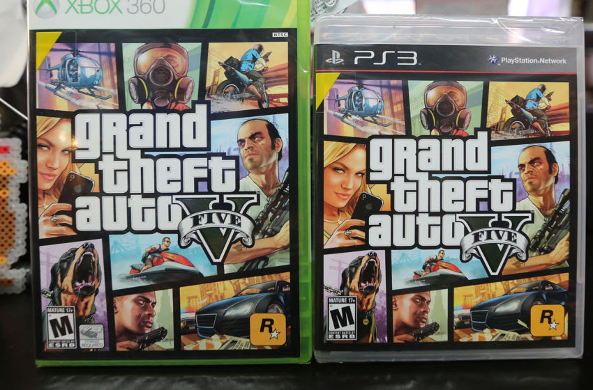 NEW YORK, NY - SEPTEMBER 18: Copies of Grand Theft Auto V are displayed at the 8 Bit & Up video games shop in Manhattan's East Village on September 18, 2013 in New York City. The video game raked in more than $800 million in sales in its first 24 hours on the shelves. (Photo Illustration by Mario Tama/Getty Images)