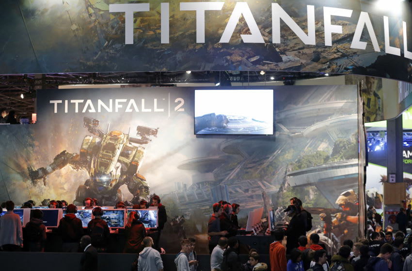 PARIS, FRANCE - OCTOBER 26: Visitors wait to play the video game 'Titanfall 2' developed by Respawn Entertainment and published by Electronic Arts during the