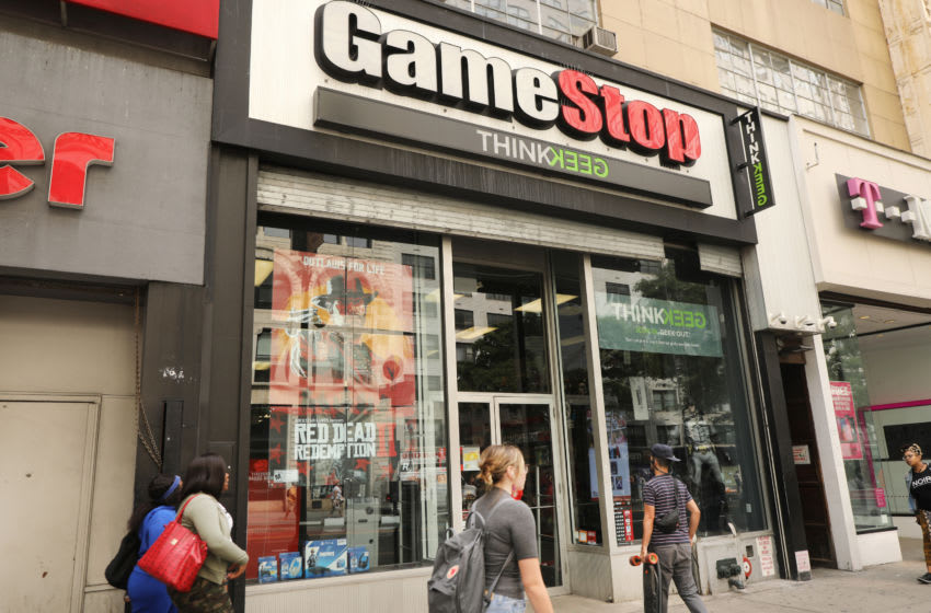 NEW YORK, NEW YORK - SEPTEMBER 16: People pass a GameStop store in lower Manhattan on September 16, 2019 in New York City. GameStop has announced that they will be closing between 180 and 200 stores before the end of the fiscal year due to a drop in sales. (Photo by Spencer Platt/Getty Images)
