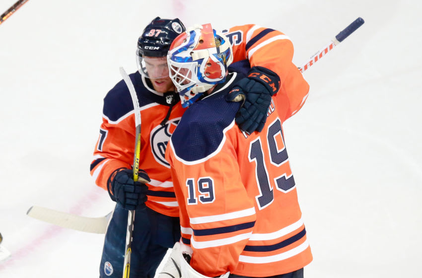 EDMONTON, ALBERTA - AUGUST 03: Connor McDavid #97 and Mikko Koskinen #19 of the Edmonton Oilers (Photo by Jeff Vinnick/Getty Images)