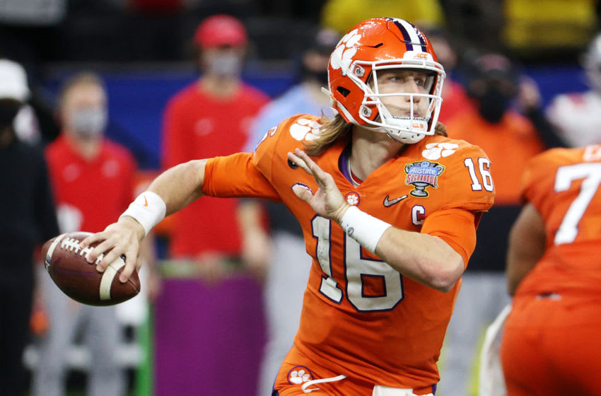NEW ORLEANS, LOUISIANA - JANUARY 01: Trevor Lawrence #16 of the Clemson Tigers looks to pass in the second half against the Ohio State Buckeyes during the College Football Playoff semifinal game at the Allstate Sugar Bowl at Mercedes-Benz Superdome on January 01, 2021 in New Orleans, Louisiana. (Photo by Chris Graythen/Getty Images)