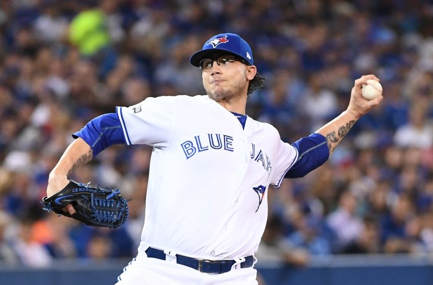 Oct 17, 2016; Toronto, Ontario, CAN; Toronto Blue Jays relief pitcher Brett Cecil (27) delivers a pitch against the Cleveland Indians during the seventh inning in game three of the 2016 ALCS playoff baseball series at Rogers Centre. Mandatory Credit: Nick Turchiaro-USA TODAY Sports