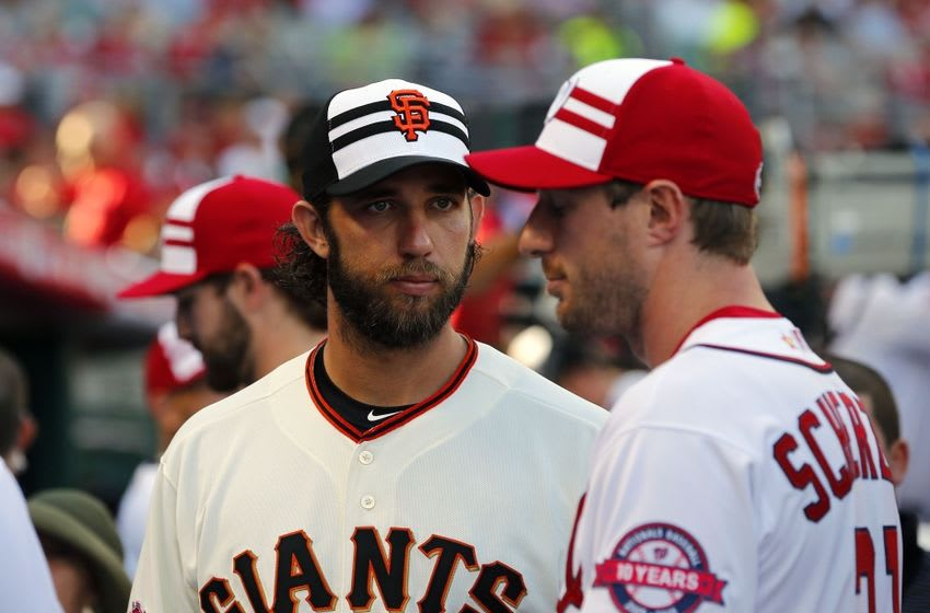 Pitching aces Madison Bumgarner and Max Scherzer face off at the 2015 MLB All-Star Game—for a friendly off-field chat. Rick Osentoski-USA TODAY Sports