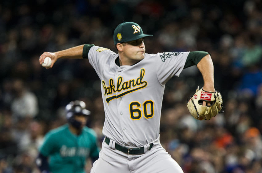 SEATTLE, WA - APRIL 13: Andrew Triggs #60 of the Oakland Athletics delivers against the Seattle Mariners in the third inning at Safeco Field on April 13, 2018 in Seattle, Washington. (Photo by Lindsey Wasson/Getty Images)