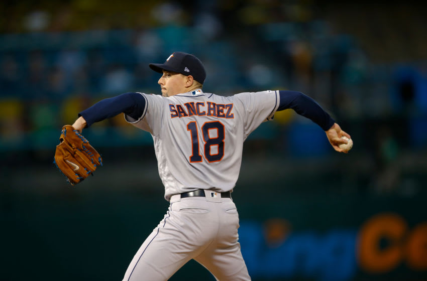 OAKLAND, CA - AUGUST 15: Aaron Sanchez #18 of the Houston Astros pitches during the game against the Oakland Athletics at the Oakland-Alameda County Coliseum on August 15, 2019 in Oakland, California. The Athletics defeated the Astros 7-6. (Photo by Michael Zagaris/Oakland Athletics/Getty Images)