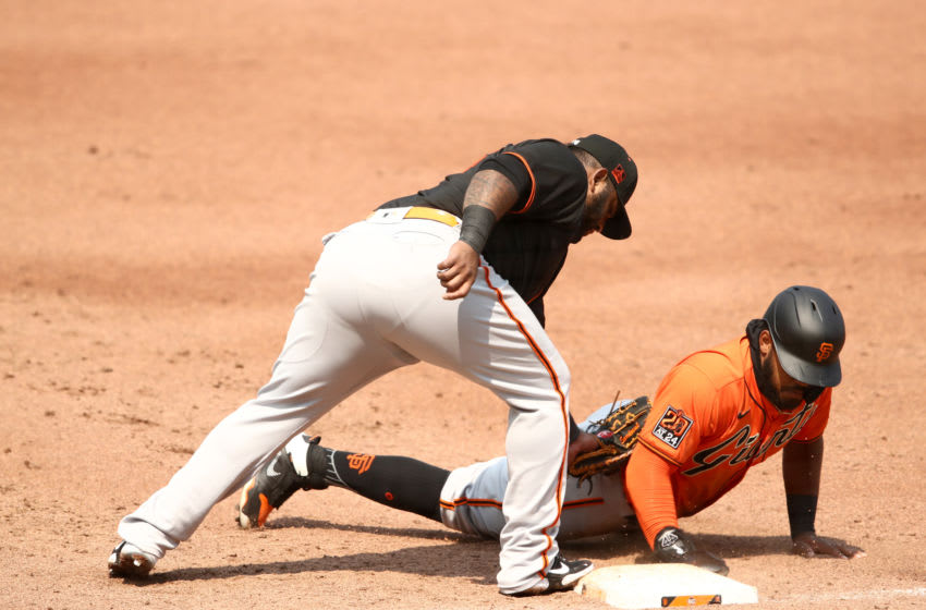 SAN FRANCISCO, CALIFORNIA - JULY 15: Heliot Ramos of the San Francisco Giants slides safely back in to first base that is covered by Pablo Sandoval #48 during an intrasquad game at Oracle Park on July 15, 2020 in San Francisco, California. (Photo by Ezra Shaw/Getty Images)