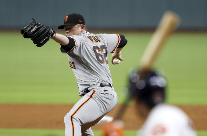 HOUSTON, TEXAS - AUGUST 10: Logan Webb #62 of the San Francisco Giants pitches in the second inning against the Houston Astros at Minute Maid Park on August 10, 2020 in Houston, Texas. (Photo by Tim Warner/Getty Images)