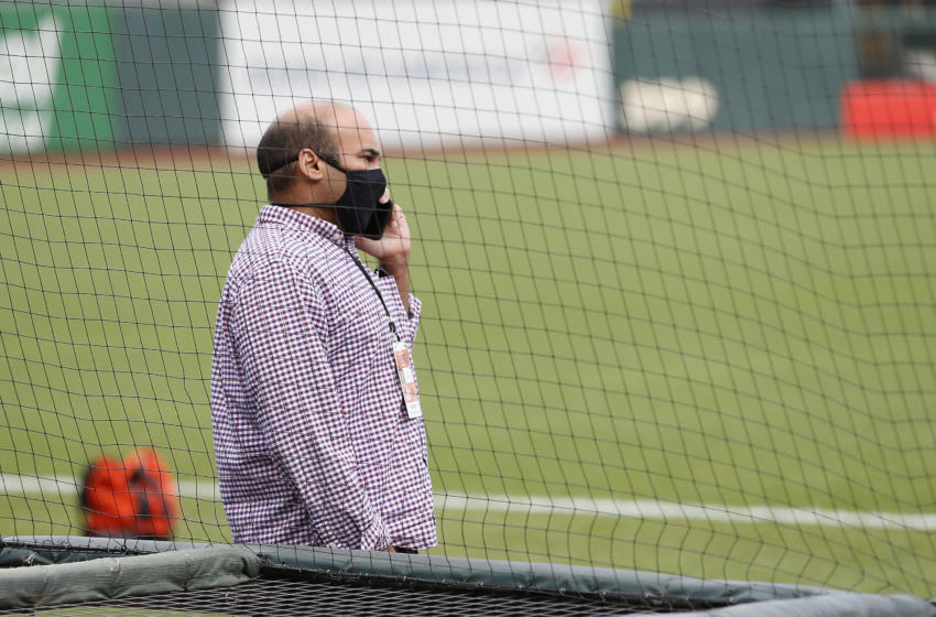 SAN FRANCISCO, CALIFORNIA - AUGUST 26: San Francisco Giants President of Baseball Operations, Farhan Zaidi, talks on the phone before the postponement of the game against the Los Angeles Dodgers at Oracle Park on August 26, 2020 in San Francisco, California. Several sporting leagues across the nation today are postponing their schedules as players protest the shooting of Jacob Blake by Kenosha, Wisconsin police. (Photo by Lachlan Cunningham/Getty Images)