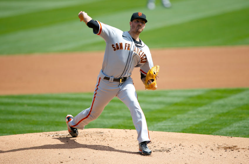 OAKLAND, CA - SEPTEMBER 19: Kevin Gausman #34 of the San Francisco Giants pitches during the game against the Oakland Athletics at RingCentral Coliseum on September 19, 2020 in Oakland, California. The Athletics defeated the Giants 6-0. (Photo by Michael Zagaris/Oakland Athletics/Getty Images)