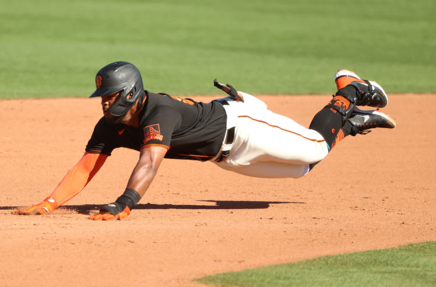 SCOTTSDALE, ARIZONA - MARCH 28: Heliot Ramos #80 of the SF Giants dives safely into second base in the eight inning against the Oakland Athletics during the MLB spring training game at Scottsdale Stadium on March 28, 2021 in Scottsdale, Arizona. (Photo by Abbie Parr/Getty Images)