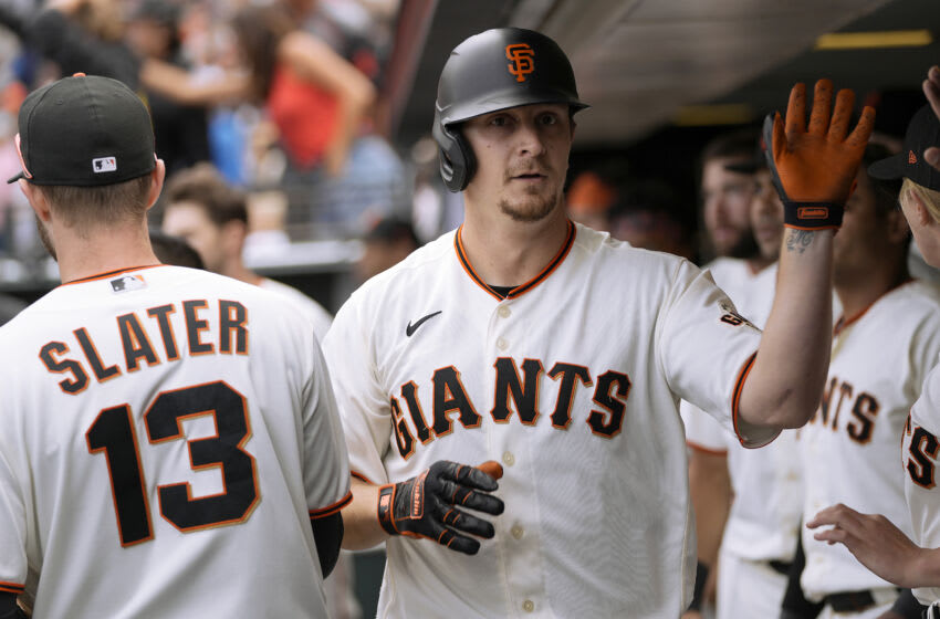 SAN FRANCISCO, CALIFORNIA - JULY 05: Alex Dickerson #12 of the San Francisco Giants is congratulated by teammates after he hit a pinch hit solo home run against the San Francisco Giants in the bottom of the eighth inning at Oracle Park on July 05, 2021 in San Francisco, California. (Photo by Thearon W. Henderson/Getty Images)