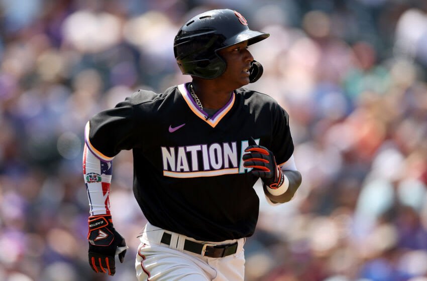 DENVER, COLORADO - JULY 11: Marco Luciano #10 of the National League plays the American League team during the MLB All-Star Futures Game at Coors Field on July 11, 2021 in Denver, Colorado. (Photo by Matthew Stockman/Getty Images)