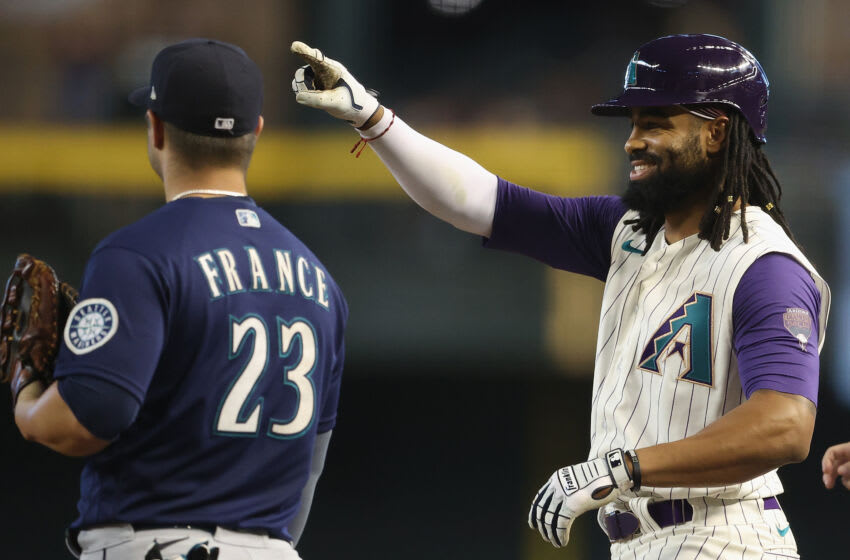 PHOENIX, ARIZONA - SEPTEMBER 05: Henry Ramos #14 of the Arizona Diamondbacks reacts after hitting a single on his first career at-bat during the seventh inning of the MLB game against the Seattle Mariners at Chase Field on September 05, 2021 in Phoenix, Arizona. Ramos has previously played in the SF Giants organization and is the older brother of prospect Heliot Ramos. (Photo by Christian Petersen/Getty Images)