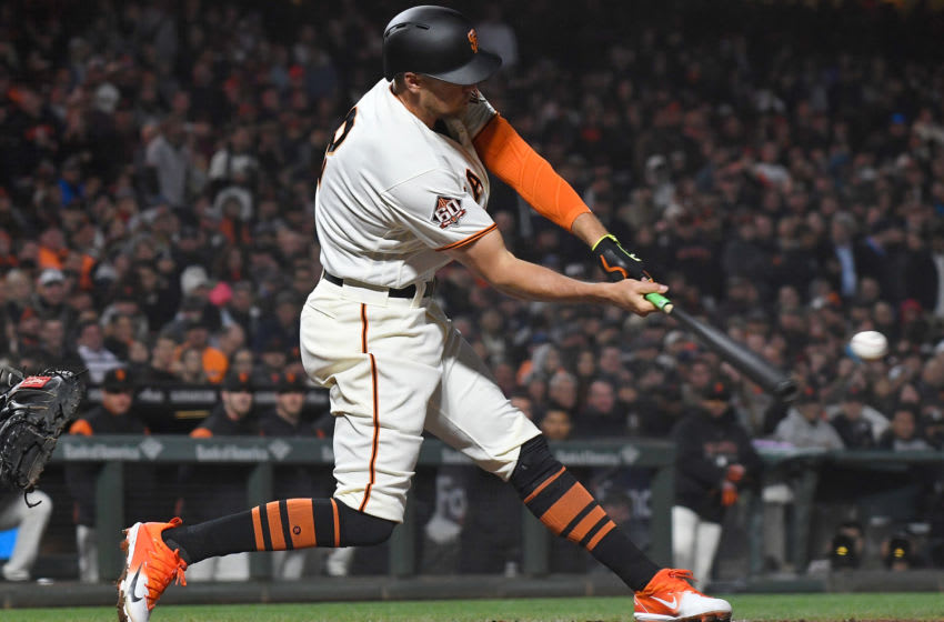SAN FRANCISCO, CA - APRIL 10: Hunter Pence #8 of the San Francisco Giants hits an rbi sacrifice fly scoring Brandon Belt #9 against the Arizona Diamondbacks in the bottom of the six inning at AT&T Park on April 10, 2018 in San Francisco, California. (Photo by Thearon W. Henderson/Getty Images)