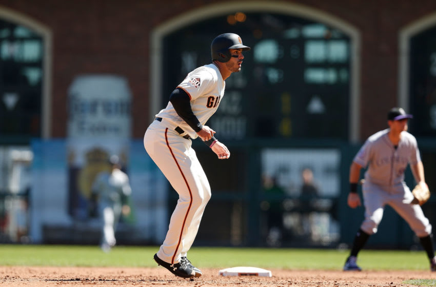 SAN FRANCISCO, CA - SEPTEMBER 16: Base runner Chris Shaw #26 of the San Francisco Giants leads off of second base in the second inning against the Colorado Rockies at AT&T Park on September 16, 2018 in San Francisco, California. (Photo by Lachlan Cunningham/Getty Images)