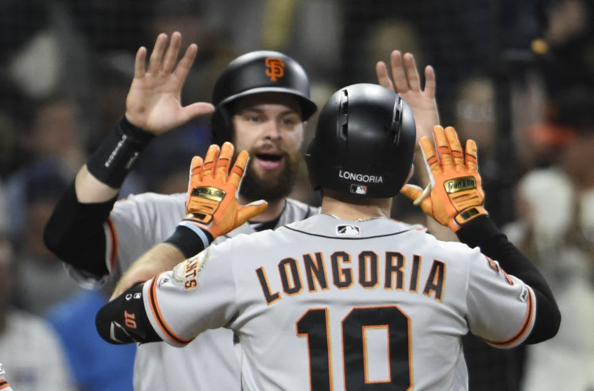 After another round of negative COVID-19 tests, the SF Giants and San Diego Padres have been cleared to return to action on Sunday. (Photo by Denis Poroy/Getty Images)