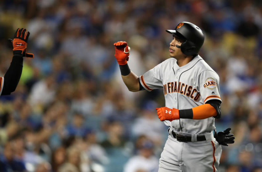 LOS ANGELES, CA - SEPTEMBER 6: Mauricio Dubon #19 of the San Francisco Giants celebrates during the game against the Los Angeles Dodgers at Dodger Stadium. (Photo by Rob Leiter/MLB Photos via Getty Images)